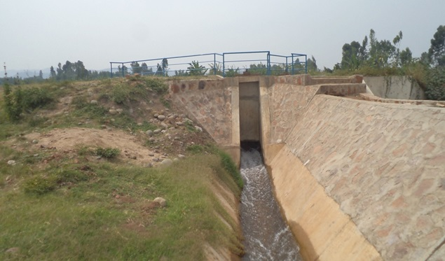 A river diversion structure (background) and main canal taking water to farmland.